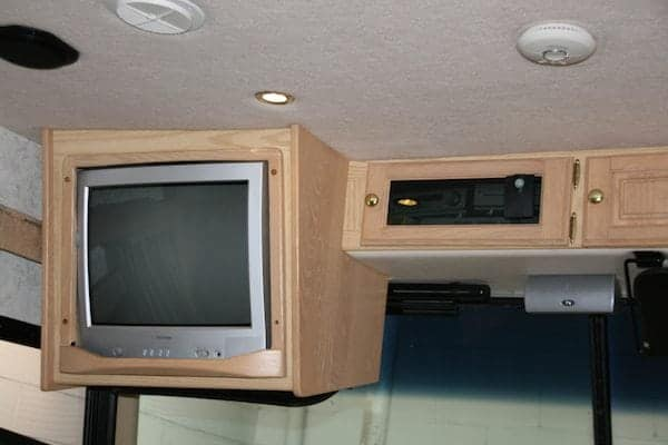 TV above the driver's head.