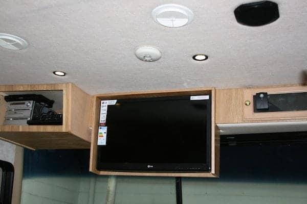 A conversion using the original TV aperture as a cupboard