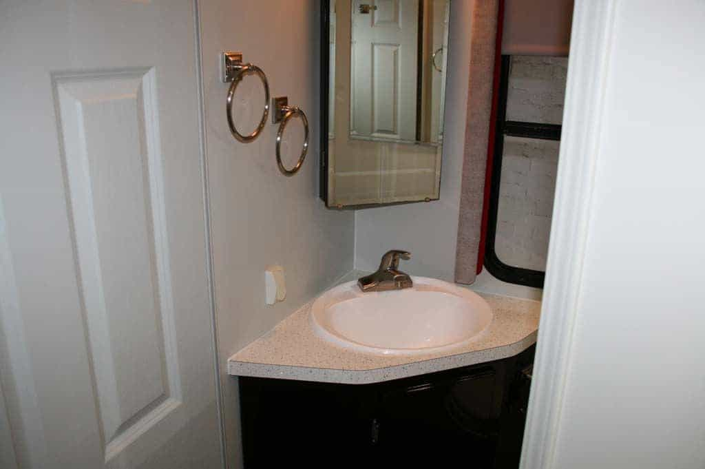 The toilet area with the new sink top and new window pelmet.