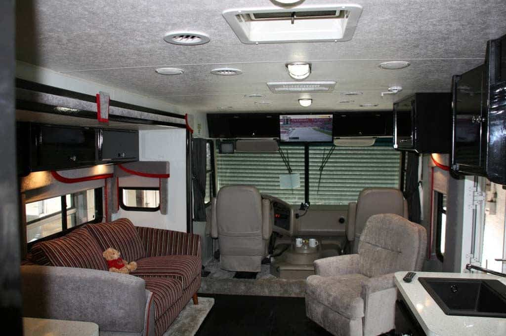 The front area with the grey carpet and TV conversion.