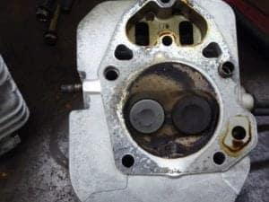 Cummins Onan Generator grey exhaust valve and darker inlet valve