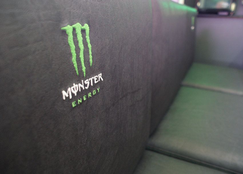 closeup of the hand stitched Monster Energy logo on the seating